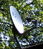 A DIRECTVsatellite dish on a roof