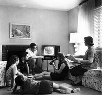 An American family watching television in the 1950s.