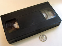 Top view VHS cassette with U.S. Quarter for scale
